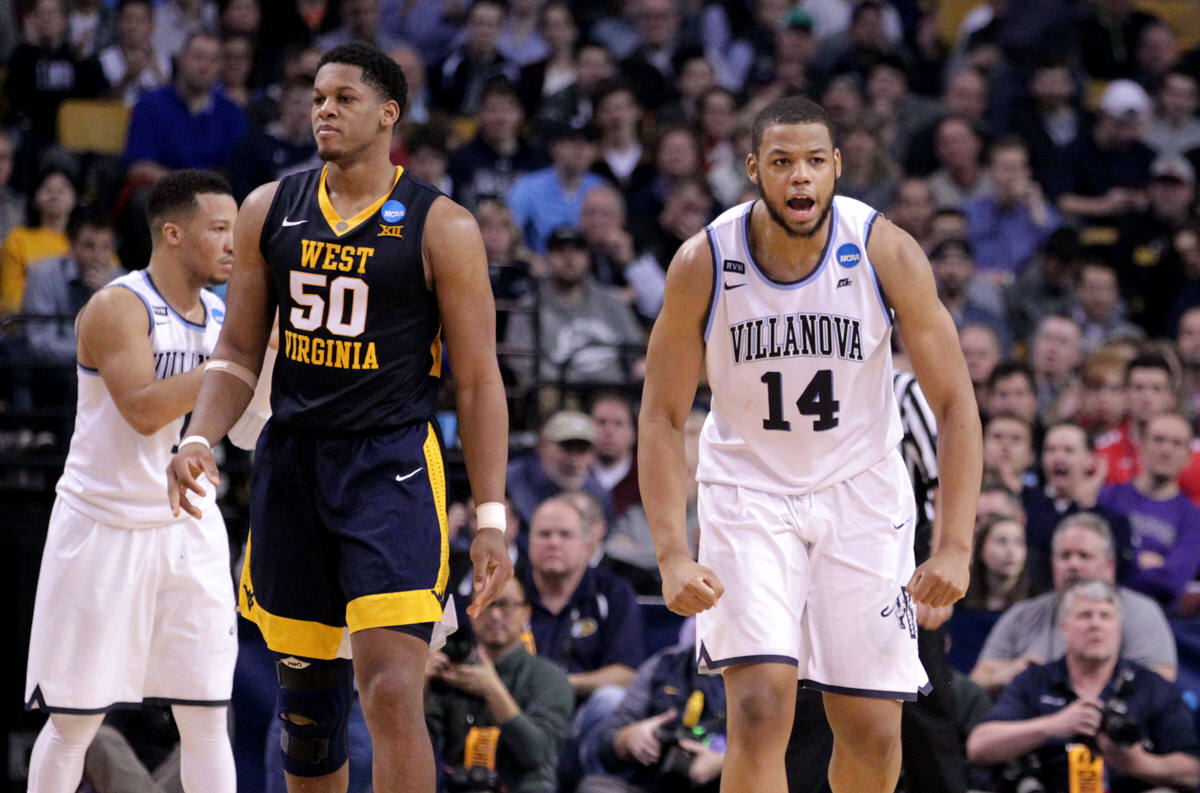 Omari Spellman celebrates during a Villanova run in the first half of the East Regional semifinals vs. Sagaba Konate (left) and West Virginia at TD Garden.  (CHARLES FOX / Staff Photographer)