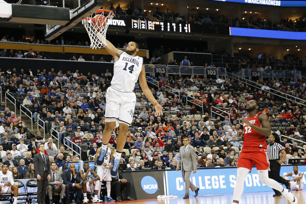 Villanova forward Omari Spellman throws down a dunk against Radford during the first round of the NCAA tournament at PPG Paints Arena in Pittsburgh.  (YONG KIM / Staff Photographer)